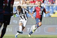 Juventus' Emanuele Giaccherini (L) kicks the ball during the Italian Serie A football match Genoa vs Juventus at Luigi Ferraris stadium in Genova. Two late goals from Mirko Vucinic and Kwadwo Asamoah sent Serie A champions Juventus back to the top of the table thanks to a 3-1 win away to Genoa on Sunday