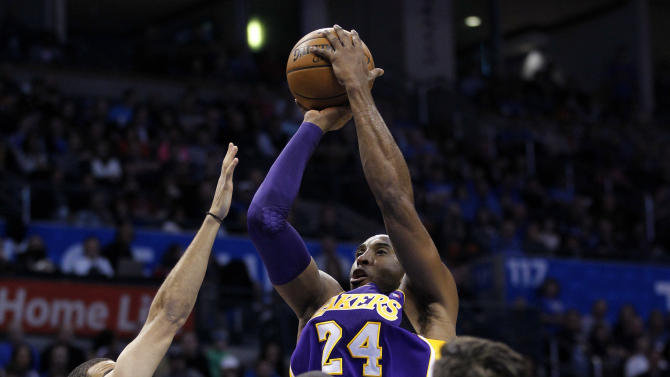 Los Angeles Lakers guard Kobe Bryant (24) shoots over Oklahoma City Thunder guard Kevin Martin (23), forward Serge Ibaka (9) and forward Nick Collison (4) during the first quarter of an NBA basketball game in Oklahoma City, Friday, Dec. 7, 2012. (AP Photo/Sue Ogrocki)