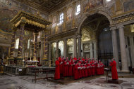 The Choir of the Westminster Abbey, directed by James O'Donnel, right, perform during a concert of Sacred Choral Music, in the St. Mary Major basilica, in Rome, Wednesday, June 27, 2012. The Westminster Abbey Choir, the world-renowned chorus which last year performed at the wedding of Prince William and Kate Middleton, will join the Sistine singers at a special papal Mass on Friday in St. Peter's Basilica, a historic event seen as a perfect symbol of Christian harmony _ after centuries of discord. It's the first time in its 500-plus year history that the pope's personal choir will be accompanied by another chorus, let alone one that comes from the breakaway Anglican Church. (AP Photo/Andrew Medichini)