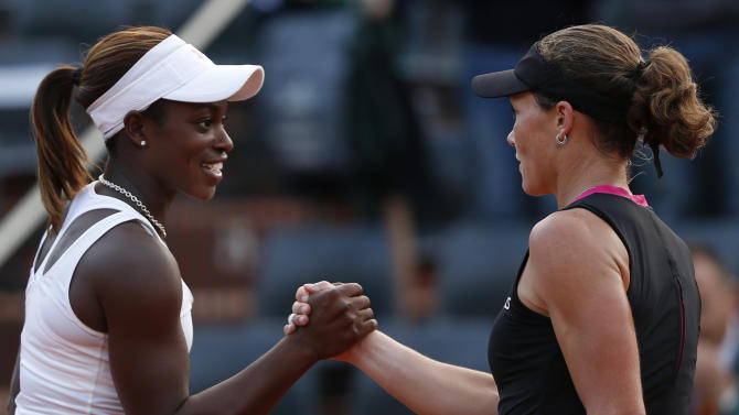 USA's Sloane Stephens, left, shakes hands with Australia's Samantha Stosur after their fourth round match in the French Open tennis tournament at the Roland Garros stadium in Paris, Sunday, June 3, 2012.  Stosur won 7-5, 6-4. (AP Photo/Bernat Armangue)