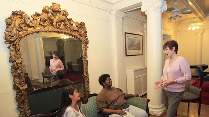 Mary Carol, right, executive director of Cincinnati Union Bethel talks with residents Sherene Julian, left, and Robin Howard, in the lounge at the Anna Louise Inn, Monday, Sept. 24, 2012, in Cincinnati. Western & Southern wants the 103 year old home for women to leave the picturesque downtown neighborhood that they share in favor of a boutique hotel. (AP Photo/Al Behrman)