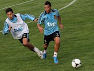 Spain national football team players Jesus Navas (L) and Santiago Cazorla during a training session on May 24. Reigning European champions Spain take on Serbia with a host of fringe players expected to get their chance to impress coach Vicente Del Bosque