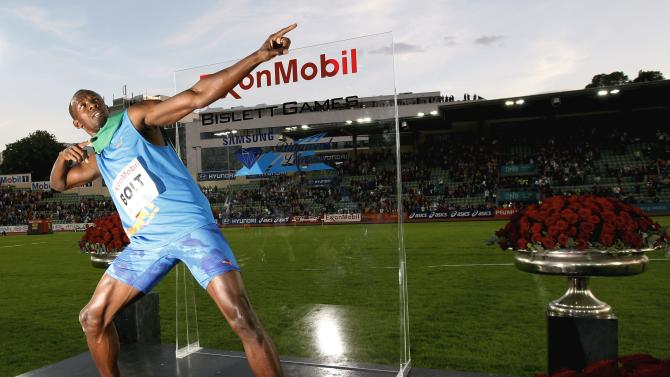 Usain Bolt of Jamaica reacts after winning men`s 100m at the IAAF Diamond League athletics meeting at Bislett Stadium in Oslo, Thursday June 7, 2012. (AP Photo / Lise Aaserud, NTB scanpix) NORWAY OUT