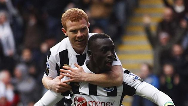 Adam Campbell celebrates with Papiss Cisse (Reuters)