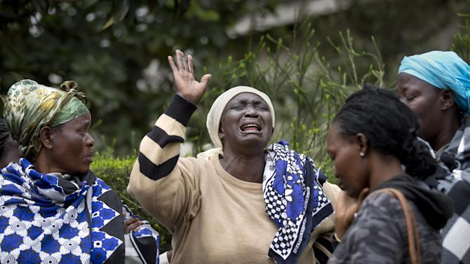 Mary Italo, center, grieves with other relatives for her son Thomas Abayo Italo, 33, who was killed in the Westgate Mall attack, as they wait to receive his body at the mortuary in Nairobi, Kenya Wednesday, Sept. 25, 2013. Thomas was an accountant and the breadwinner of the family who helped look after Mary who is sick, according to relatives. Kenyan authorities prepared for the gruesome task of recovering dozens more victims than initially feared after the country's president declared an end Tuesday to the four-day siege of the Nairobi mall by al-Qaida-linked terrorists. (AP Photo/Ben Curtis)