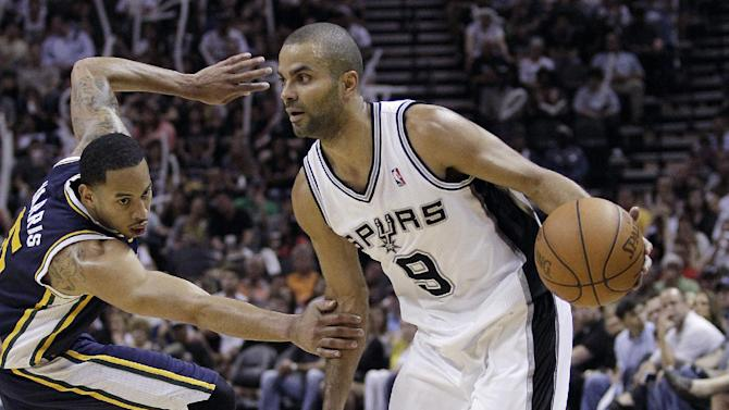San Antonio Spurs' Tony Parker (9), of France, is defended by Utah Jazz's Devin Harris, left, during the third quarter of Game 1 of a first-round NBA basketball playoff series on Sunday, April 29, 2012, in San Antonio.  San Antonio won 106-91. (AP Photo/Eric Gay)