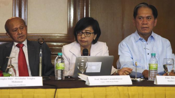 Philippines government chief peace negotiator Miriam Coronel-Ferrer speaks at a joint news conference of the Government of the Philippines and the Moro Islamic Liberation Front (MILF) at a hotel in Kuala Lumpur