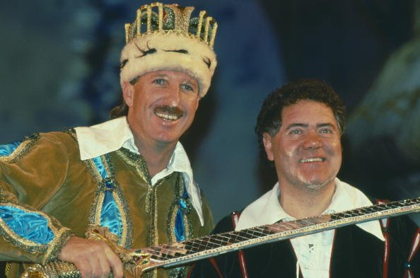 English cricketer Ian Botham stars in the pantomime 'Jack and the Beanstalk' in Bournemouth, with Welsh comedian Max Boyce (right), December 1991. (Photo by Chris Cole/Getty Images)