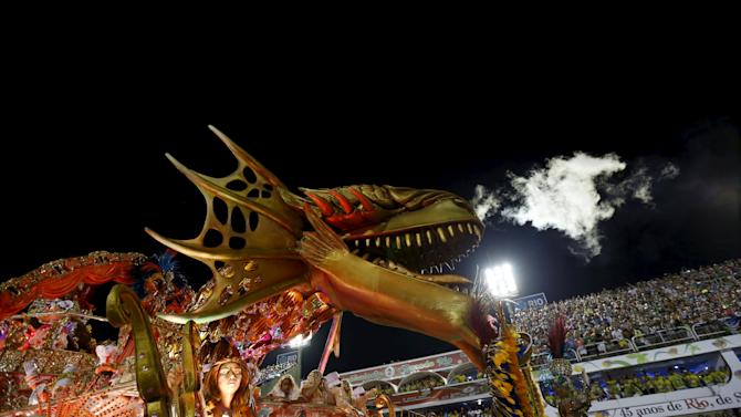 Revellers of Beija-Flor samba school perform during the carnival parade at the sambadrome in Rio de Janeiro
