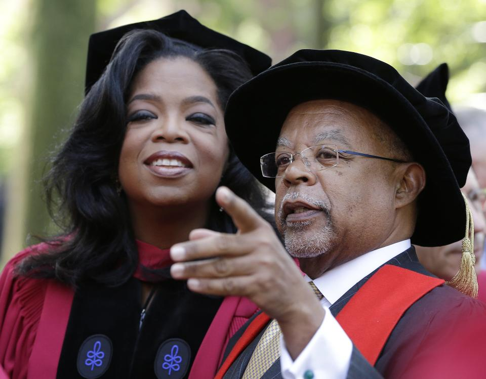 Prof. Henry Louis Gates points something out to Oprah Winfrey prior to her receiving an honorary degree from Harvard University at commencement ceremonies in Cambridge, Mass., Thursday, May 30, 2013. (AP Photo/Elise Amendola)