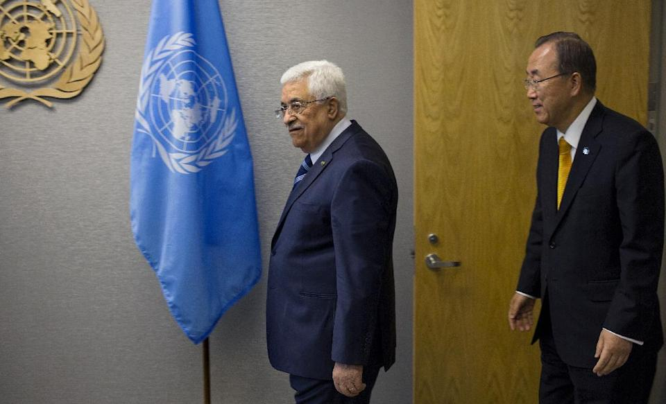 Palestinian President Mahmoud Abbas arrives with United Nations Secretary-General Ban Ki-moon for a photo opportunity during the 68th session of the United Nations General Assembly at United Nations headquarters Tuesday, Sept. 24, 2013. (AP Photo/Craig Ruttle)