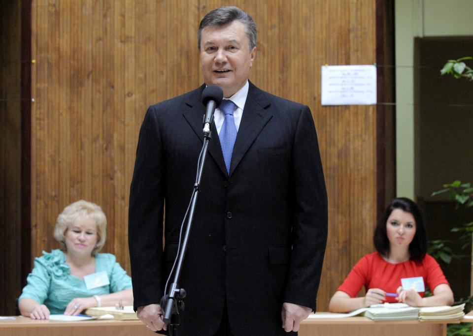 Ukrainian President Viktor Yanukovich speaks to reporters at a polling station during parliamentary elections in Kiev, Ukraine, Sunday, Oct. 28, 2012. (AP Photo/Sergei Chuzavkov)