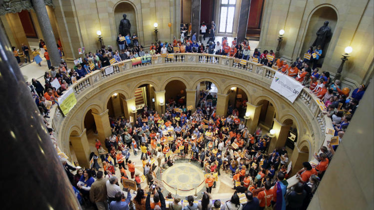 Supporters and opponents of Minnesota's gay marriage bill gather in the State Capitol  Rotunda in St. Paul as the Senate prepared to take up the issue, Monday, May 13, 2013 in St. Paul, Minn. The bill passed the Minnesota House last week. (AP Photo/Jim Mone)