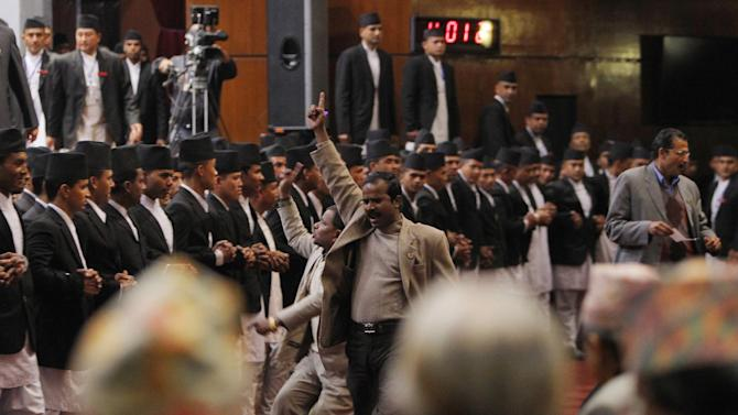 Nepalese opposition lawmakers shout slogans inside the Constituent Assembly in Kathmandu, Nepal, Sunday, Jan. 25, 2015. Nepal's ruling coalition on Sunday took a step toward drafting a new constitution, angering the opposition and pushing the Himalayan country further into political turmoil. (AP Photo/Niranjan Shrestha)