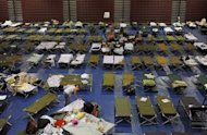 Evacuees from the Waldo Canyon fire take shelter at Cheyenne Mountain High School on June 27 in Colorado Springs, Colorado. Massive wildfires raging across Colorado have destroyed hundreds of homes and forced tens of thousands to flee, but better weather Thursday should help crews beat back the blazes