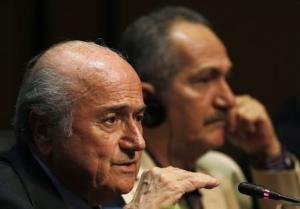 FIFA President Sepp Blatter gestures next Brazil's Sport minister Aldo Rebelo as they attend a media conference in Sao Paulo