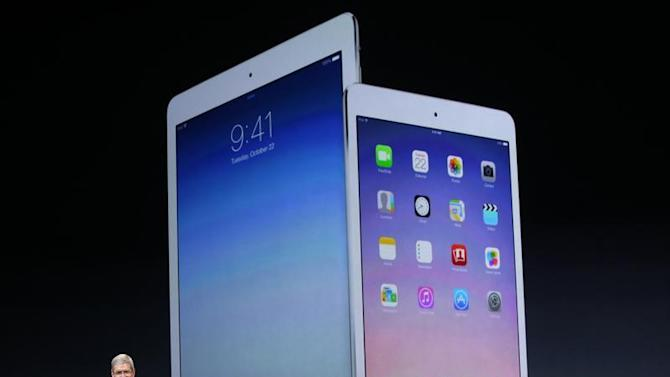 Apple Inc CEO Tim Cook speaks about the new iPad Air and the iPad mini with Retina display during an Apple event in San Francisco