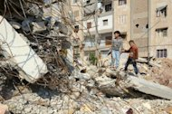 Syrian boys clamber across the rubble of a building destroyed in an air strike by Syrian regime forces in an area controlled by rebel fighters in the Bustan al-Bashar district of Aleppo. Air raids, clashes and car bombings shook Syria on Sunday, killing nearly 100 people, monitors said, as world powers look to pick up the pieces of a failed bid to bring in a Muslim holiday ceasefire