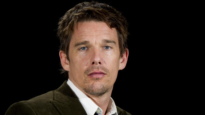 """This June 11, 2012 photo shows actor Ethan Hawke in New York. Hawke portrays a frustrated American writer who moves to Paris to be closer to his young daughter in """"The Woman in the Fifth.""""   (Photo by Charles Sykes/Invision/AP)"""