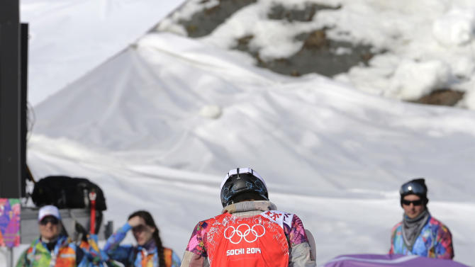 Lindsey Jacobellis of the United States walks off after crashing in the second semifinal of the women's snowboard cross at the Rosa Khutor Extreme Park, at the 2014 Winter Olympics, Sunday, Feb. 16, 2014, in Krasnaya Polyana, Russia. (AP Photo/Andy Wong)