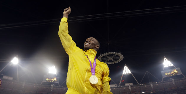 Jamaica's Usain Bolt reacts after receiving a gold medal for the men's 4x100-meter during the athletics in the Olympic Stadium at the 2012 Summer Olympics, London, Saturday, Aug. 11, 2012. (AP Photo/Matt Slocum)