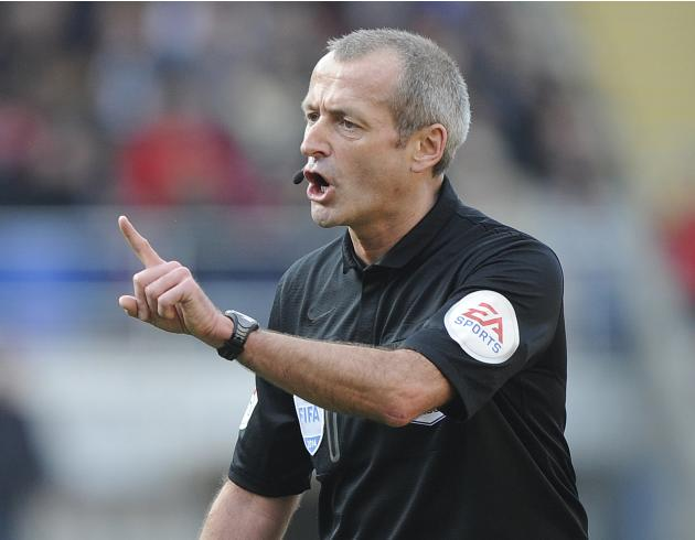 Referee Martin Atkinson gestures during the English Premier League soccer match between Cardiff City and Fulham in Cardiff