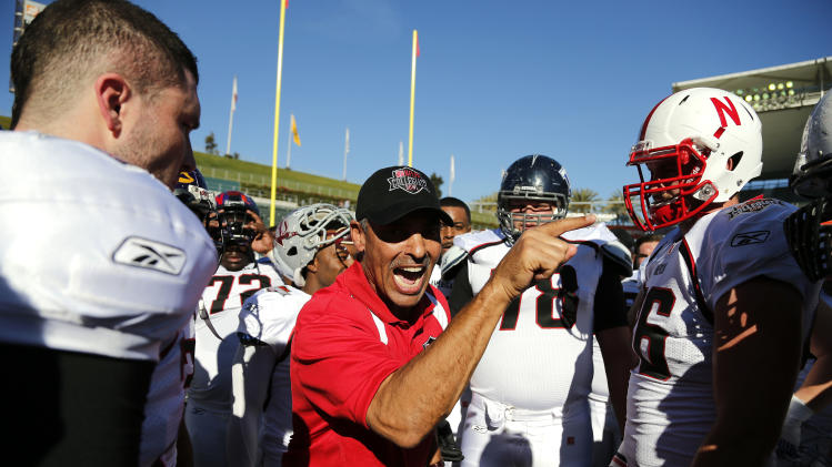 IMAGE DISTRIBUTED BY AP IMAGES FOR NFLPA- American team head coach Herm Edwards talks with his team before the NFLPA Collegiate Bowl on Saturday, Jan. 19, 2013 in Carson, Calif. (Ric Tapia/AP Images for NFLPA)
