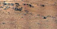 This image released by NASA on October 4, shows patch of windblown sand and dust downhill from a cluster of dark rocks called the 'Rocknest' site, which has been selected as the likely location for first use of the scoop on the arm of NASA's Mars rover Curiosity