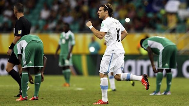 Uruguay's Diego Forlan celebrates after scoring a goal against Nigeria during their Confederations Cup Group B match at the Arena Fonte Nova in Salvador June 20, 2013.