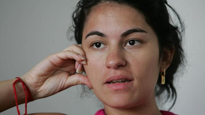 In this June 29, 2009 photo, late Brazilian model Eliza Samudio speaks during an interview in Rio de Janeiro Brazil. The trial of Bruno Fernandes, known in Brazil just as Bruno, charged with orchestrating the kidnapping and gruesome murder of Samudio, an ex-girlfriend of him, started Monday with courtroom arguments that caused two lawyers to abandon the case, and with a tearful plea for justice from the victim's mother.  (AP Photo/Felipe O' Neill-Agencia O Dia)