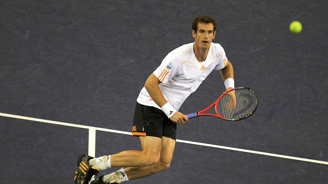 Andy Murray of Britain prepares to return the ball against Alexandr Dolgopolov of Ukraine during their third round match of the Shanghai Masters tennis tournament at Qizhong Forest Sports City Tennis Center in Shanghai, China, Thursday, Oct. 11, 2012. Murray won 6-2, 6-2. (AP Photo/Eugene Hoshiko)