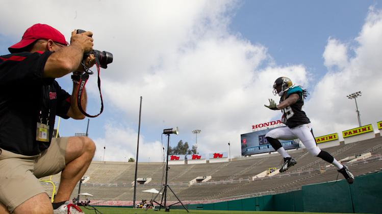IMAGE DISTRIBUTED FOR NFLPA - Jacksonville Jaguars' Denard Robinson jumps through the air during a photo-shoot at the NFLPA Rookie Premiere, on Saturday, May 18, 2013 in Pasadena, Calif. (Jeff Lewis / AP Images for NFLPA)