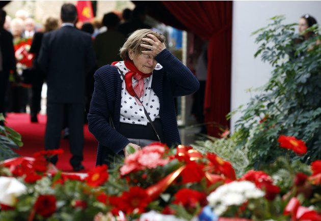 A woman mourns in front of the grave of the late Yugoslav Communist leader Tito at his mausoleum in Belgrade