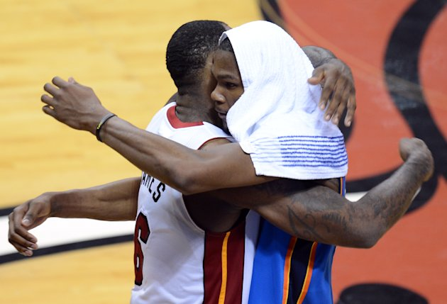 Miami Heat LeBron James (L) and Oklahoma