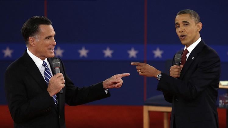 FILE - In this Tuesday, Oct. 16, 2012 file photo, Republican presidential nominee Mitt Romney and President Barack Obama spar during the second presidential debate at Hofstra University, in Hempstead, N.Y. (AP Photo/Charlie Neibergall)