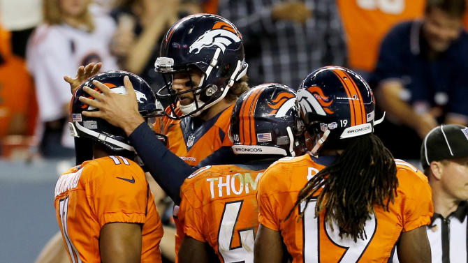 Broncos outlast flags, beat Seahawks 21-16