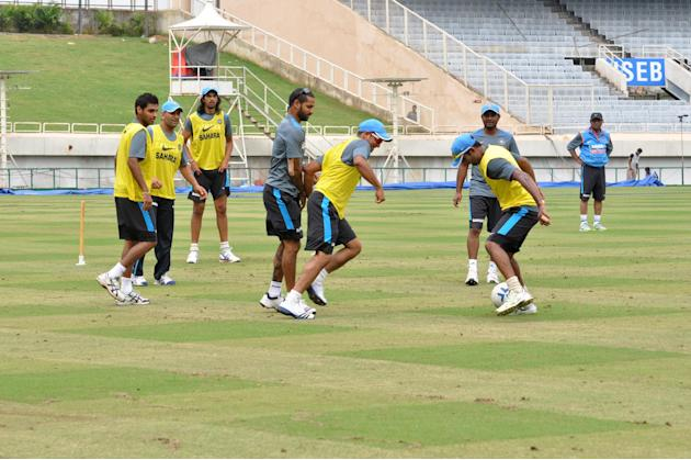 Indian Cricket team enjoys a football match during the practice session at the JSCA International Cricket Stadium ahead of 4th ODI against Australia in Ranchi on Oct.22, 2013. (Photo: IANS)