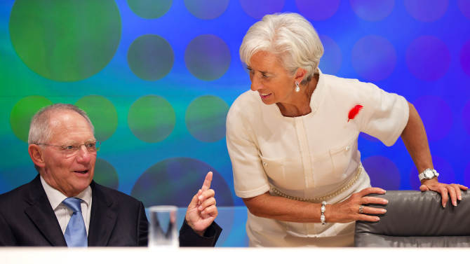"""In this photo released by the International Monetary Fund, IMF Managing Director Christine Lagarde, right, listens to German Finance Minister Wolfgang Schauble following the filming of the BBC World Debate """"Rescuing the Global Economy: What next?"""" at the annual IMF and World Bank meetings in Tokyo Friday, Oct. 12, 2012. (AP Photo/Stephen Jaffe, IMF) EDITORIAL USE ONLY"""