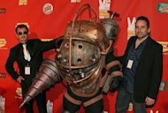 Bioshock Creative Directors Greg Gobbi (L) Ken Levine (R) pose with the &quot;Bioshock&quot; character at Spike TV&#39;s 2007 &quot;Video Game Awards&quot; in Las Vegas. Take-Two Interactive Software said on Wednesday that release of a much-anticipated &quot;BioShock Infinite&quot; videogame was postponed into early next year