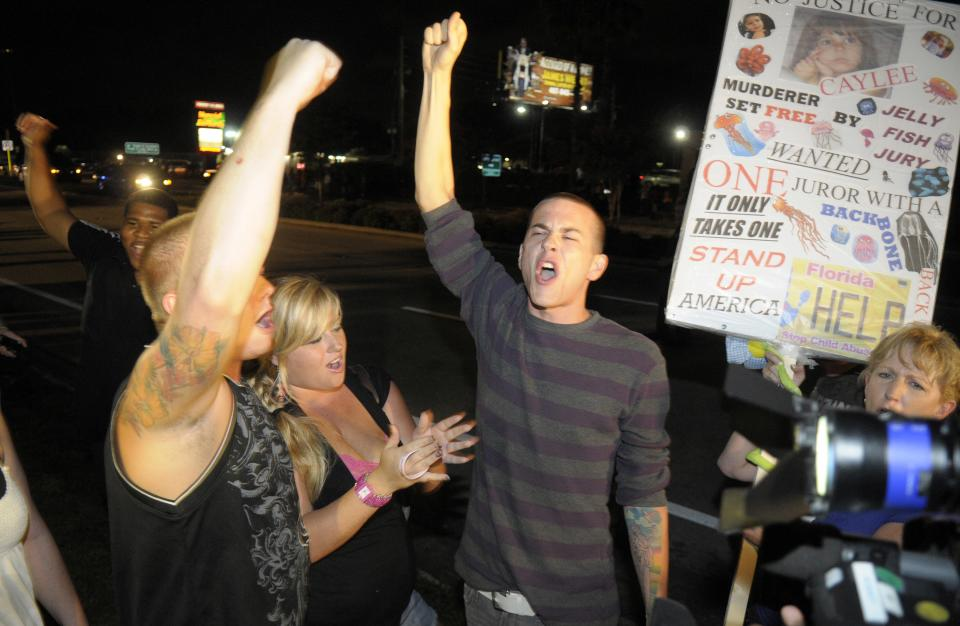 Protestors show their displeasure after Casey Anthony was released from the Orange County Jail in Orlando, Fla., early Sunday, July 17, 2011.(AP Photo/Phelan M. Ebenhack)