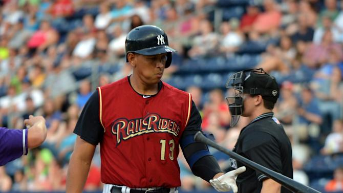New York Yankees' Alex Rodriguez flips his bat bat after striking out for the Scranton/Wilkes-Barre RailRiders against the Louisville Bats during a baseball game on Saturday, July 20, 2013, in Moosic, Pa. (AP Photo/The Scranton Times-Tribune, Jason Farmer) WILKES-BARRE TIMES-LEADER OUT