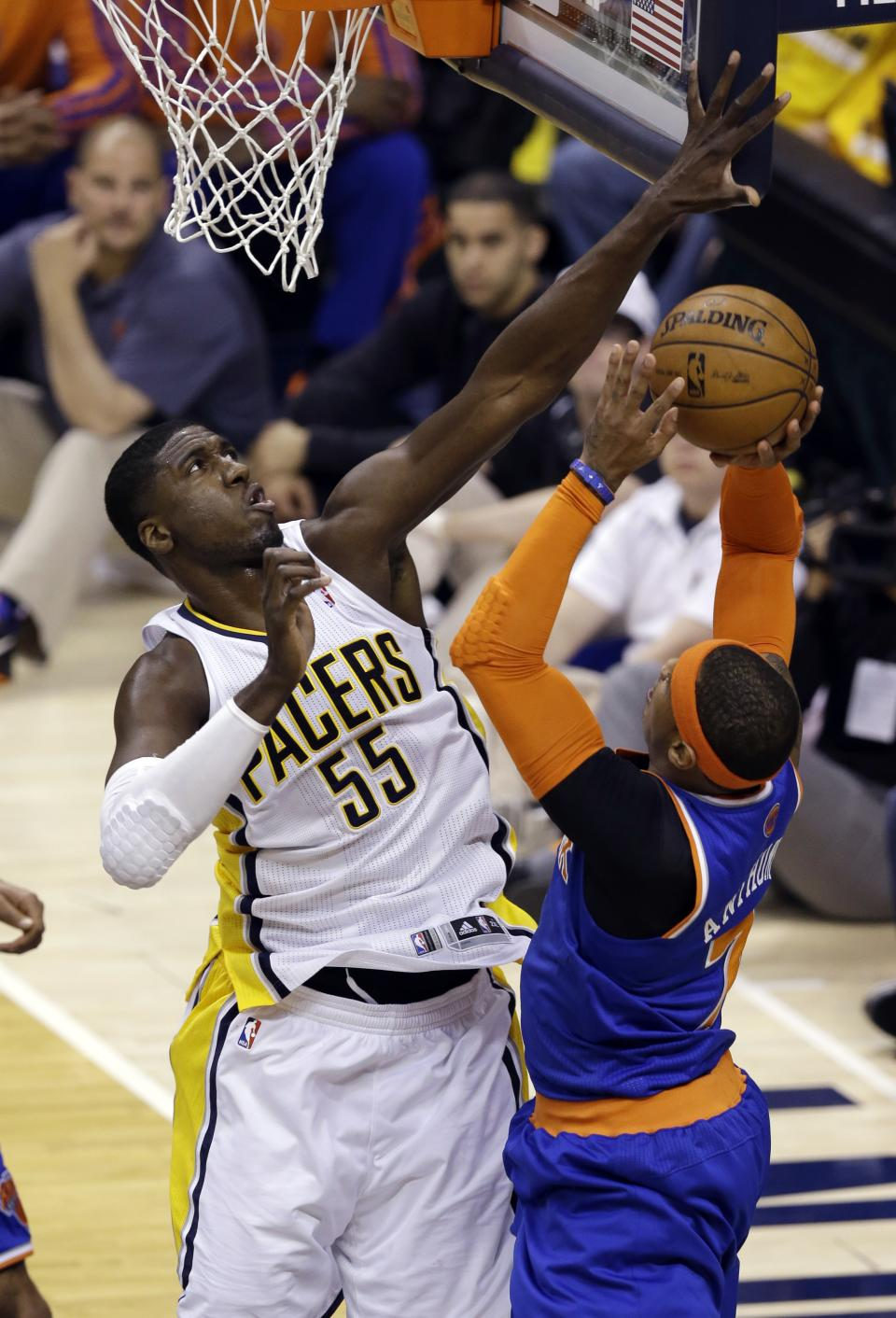Indiana Pacers center Roy Hibbert, left, fouls New York Knicks forward Carmelo Anthony who shoots during the first half of Game 3 of the Eastern Conference semifinal NBA basketball playoff series in Indianapolis, Saturday, May 11, 2013. (AP Photo/Michael Conroy)