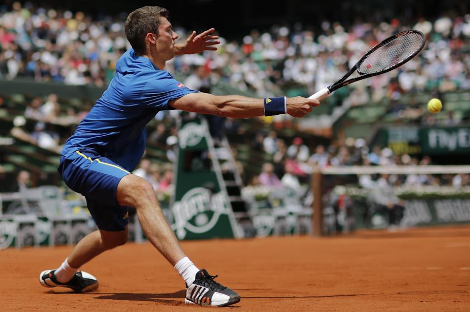 Germany's Daniel Brands returns in his first round match against Spain's Rafael Nadal at the French Open tennis tournament, at Roland Garros stadium in Paris, Monday, May 27, 2013. (AP Photo/Christophe Ena)