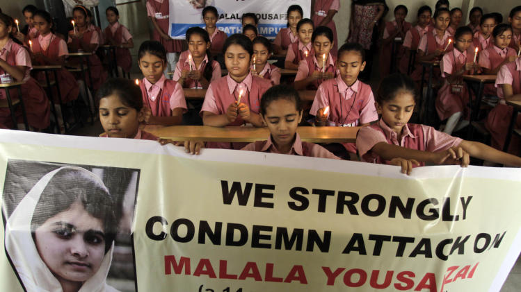 Indian students participate in a prayer ceremony in support of and for the recovery of 14-year-old schoolgirl Malala Yousufzai, who was shot in the head last Tuesday by the Taliban for speaking out in support of education for women, at a school in Ahmadabad, India, Wednesday, Oct. 17, 2012. Experts are optimistic that Yousufzai, who was airlifted Monday to Britain to receive specialized medical care, has a good chance of recovery because unlike adults, the brains of teenagers are still growing and can adapt to trauma better. (AP Photo/Ajit Solanki)
