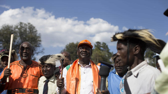 Kenyan Prime Minister and Presidential candidate, Raila Odinga, middle, takes part in a traditional dance at a rally held in Kapkatet, Kenya, Friday, Feb. 22, 2013. Kenya will hold its national elections March 4, 2013. (AP Photo/Mackenzie Knowles-Coursin)