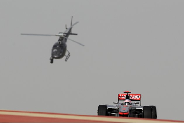 McLaren Mercedes' British driver Jenson Button drives on April 22, 2012 at the Bahrain International circuit in Manama during the Bahrain Formula One Grand Prix.     TOPSHOTS/AFP PHOTO/KARIM JAAFAR (P