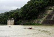 People from the Dumagat tribe ride on boats at the Ipo Dam watershed in Norzagaray town. One of the problems for the rangers is that corrupt government officials are often involved in the timber industry, according to environment activists