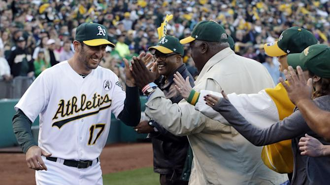 Oakland Athletics' Adam Rosales greets season ticket holders on the field prior to the opening day baseball game against the Seattle Mariners Monday, April 1, 2013, in Oakland, Calif. (AP Photo/Ben Margot)