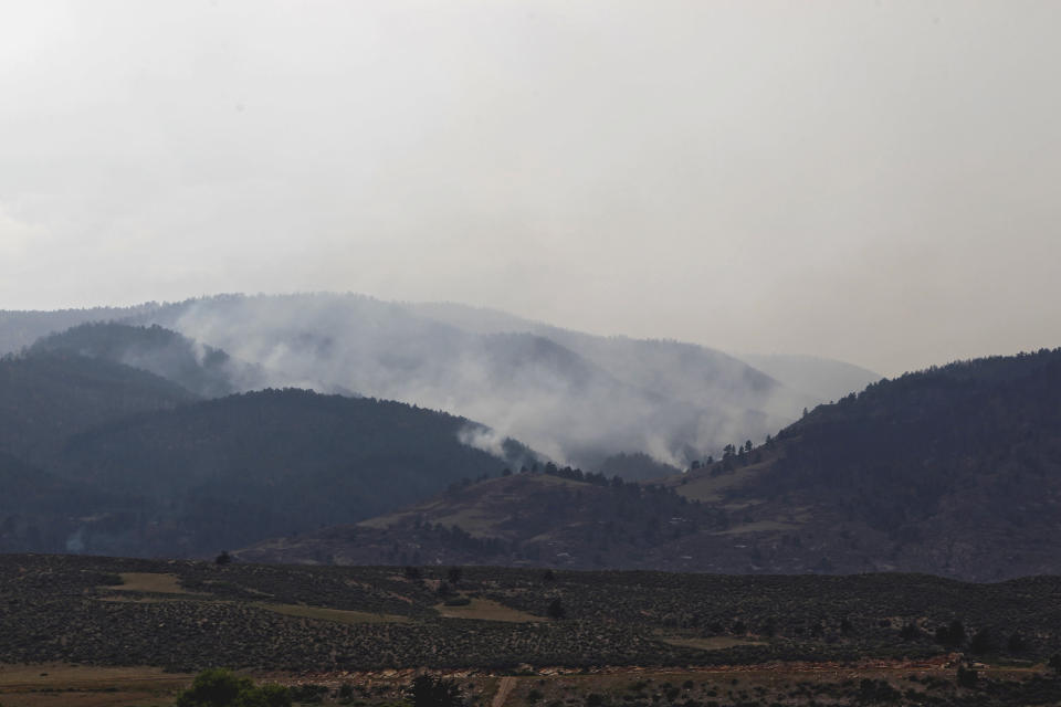 Smoke rises from the High Park wildfire west of Fort Collins, Colo., on Tuesday, June 12, 2012. The fire which started on Saturday has burned more than 40,000 acres and one person is dead as it continues to burn out of control.(AP Photo/Ed Andrieski)