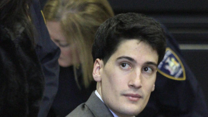 FILE - In this Friday, Feb. 17, 2012 file photo, Renato Seabra, a Portuguese model charged with castrating Portuguese TV personality Carlos Castro in a New York hotel, listens while seated handcuffed at his court hearing in New York. Seabra was convicted Friday, Nov. 30, 2012, of choking, bludgeoning and mutilating Castro. (AP Photo/Bebeto Matthews, File)